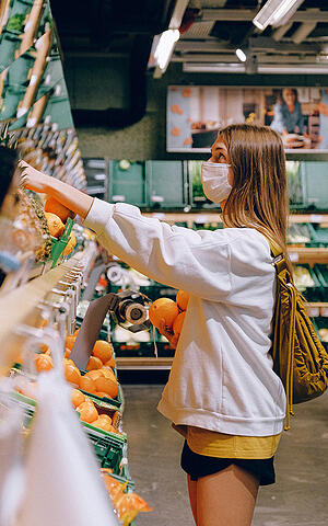 Woman shopping with COVID-19 mask